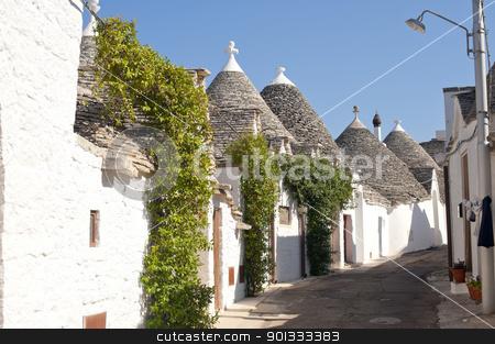 Alberobello (Bari, Puglia, Italy): Street in the trulli town stock photo, Alberobello (Bari, Puglia, Italy): Street in the trulli town by clodio