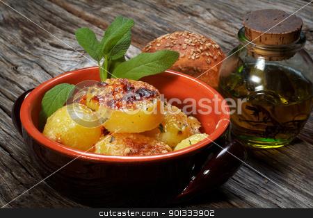 potatoes au gratin stock photo, baked potatoes au gratin on a earthen bowl by maxg71
