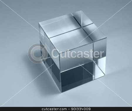 solid glass cube stock photo, physics theme with studio photography of a solid glass cube in light back, blue toned by prill