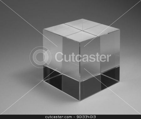 solid glass cube stock photo, studio photography of a solid glass cube with reflections in grey back by prill