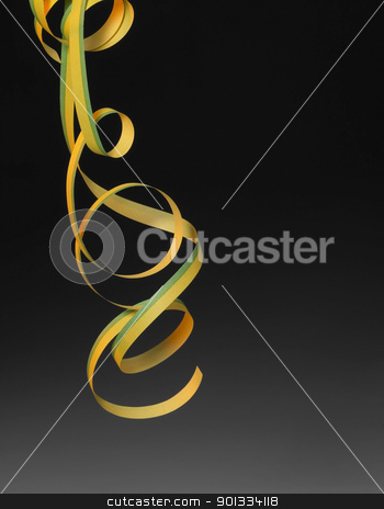 ornamental streamer stock photo, symbolic carnival background with decorative paper blow-out in dark back by prill
