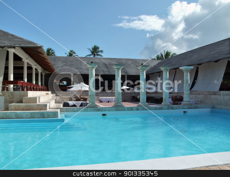 holiday resort with pool stock photo, holiday resort with pool at the Dominican Republic, a island of Hispanola wich is a part of the Greater Antilles archipelago in the Carribean region by prill