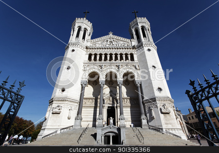 front cathedral stock photo, front of lyon Cathedral and blue sky  by vwalakte