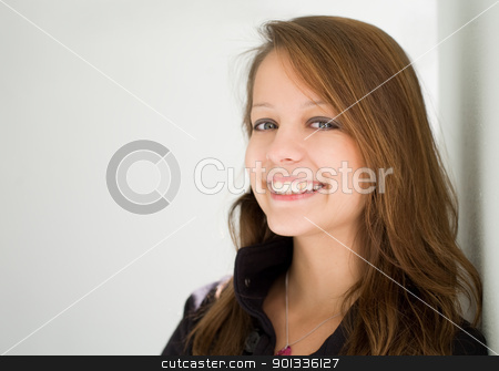 Beautiful happy brunette teen. stock photo, Closeup portrait of beautiful happy brunette teen with copy space. by exvivo