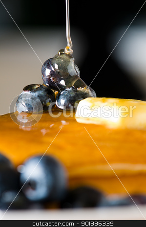 Blueberry butter pancake with honey/ maple sirup flowing down stock photo, Blueberry butter pancake with honey/ maple sirup flowing down closeup shoot by Ulrich Schade