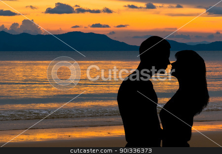 Couple in love at sunset stock photo, Couple in love at sunset on the beach by Ulrich Schade
