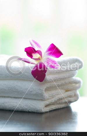 Spa towels and orchid flowers stock photo, Spa towels and orchid flowers in front of a bright background by Ulrich Schade