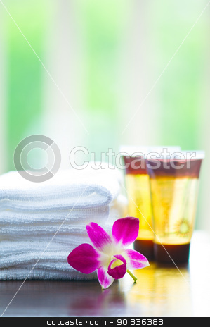 Spa ingredients and orchid flowers stock photo, Spa towels and orchid flower in front of a white green background by Ulrich Schade