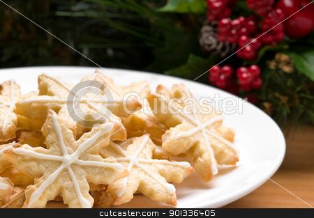 Decorated star shape christmas cookies  stock photo, Decorated christmas cookies in festive setting with tree decoration by Ulrich Schade