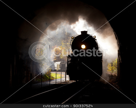 Steam locomotive enters tunnel stock photo, Old steam train pulling into a tunnel belching steam and smoke by Steven Heap