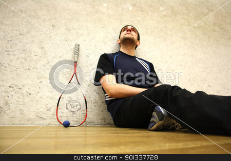 Squash stock photo, A handsome man playing squash in the hall by Viktor Thaut