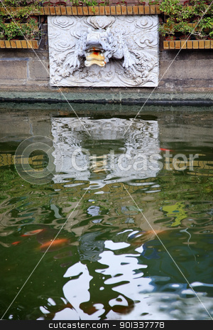 Dragon Water Spout Shanghai Yuyuan Garden with Reflections China stock photo, Dragon Stone Water Pout Yuyuan Garden Reflection Gold Fish Shanghai China by William Perry