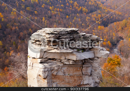 Craggy rocks in autumn stock photo, Autumn trees and colorful leaves on a hillside in the fall with a large rock tower in foreground by Steven Heap