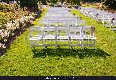 Chairs in a park stock photo, Rows of chairs in Woodland Park Rose Garden by Jaime Pharr