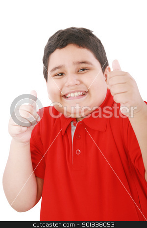 Thumbs up shown by a happy young boy  stock photo, Thumbs up shown by a happy young boy   by dacasdo
