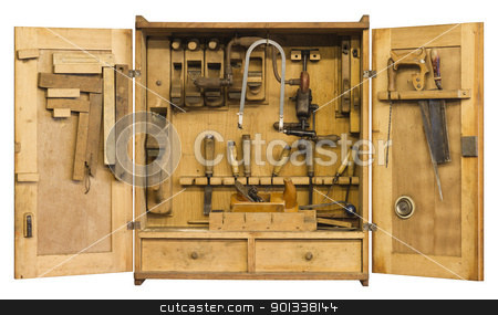 historic tool cabinet stock photo, old historic tool cabinet filled woth woodworking tools.Frontal shot with open doors in white back with clipping path by prill