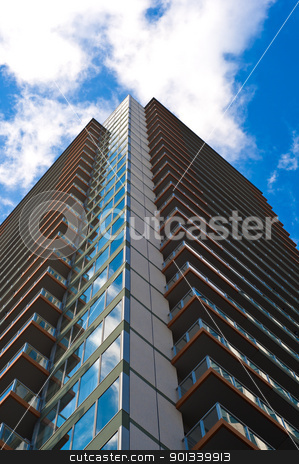 Skyscraper front view with blue sky stock photo, Office buiding front view with blue sky by Ulrich Schade