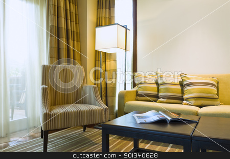 Seating area of a luxury living room stock photo, Seating area of a luxury living room in brown beige color by Ulrich Schade