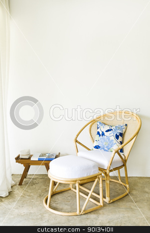 Table chair combination rattan seating area stock photo, Table chair combination rattan seating area beautiful interior design by Ulrich Schade