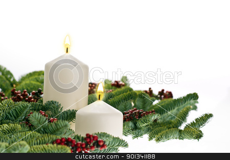 Two candles in advent setting  stock photo, Two candles in advent setting with real Christmas tree branches by Ulrich Schade