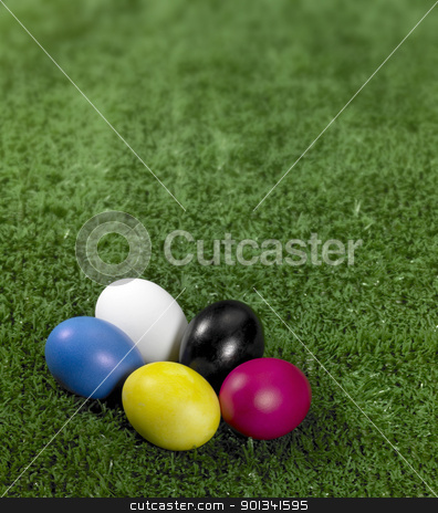 colorful Easter eggs stock photo, some colored Easter eggs in green artificial grass background by prill