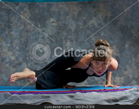 strong woman doing yoga posture Astavakrasana or  Ancient Sage w stock photo, A brown haired caucasian woman is doing yoga exercise, Astavakrasana Pose or Ancient Sage Cursed with Crooked Limbs  posture  on yoga mat in studio with mottled background.  by Stephen Orsillo
