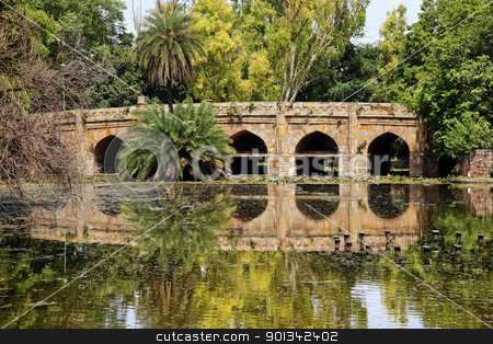 Athpula Stone Bridge Reflection  Lodi Gardens New Delhi India stock photo,  Athpula Eight Piers Stone Bridge Reflection Lodi Gardens New Delhi India 17th Century Bridge by William Perry