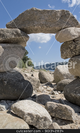 pebble archway at summer time stock photo, sunny illuminated low angle shot of a pebble archway at the Schluchsee in the Black Forest (Southern Germany) by prill