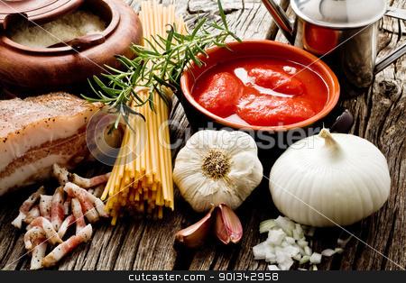 amatriciana ingredients stock photo, italian traditional pasta amatriciana ingredients on wood by maxg71