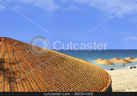 Beach view behind umbrella stock photo, Sand beach view behind umbrella by Georgios Kollidas