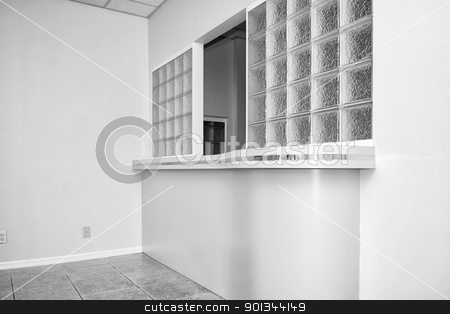 reception window stock photo, view of glass block reception window in empty office building by Stephen Orsillo