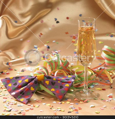 symbolic carnival and party scenery stock photo, carnival background with filled champagne glass in floating satin back with streamers and confetti by prill