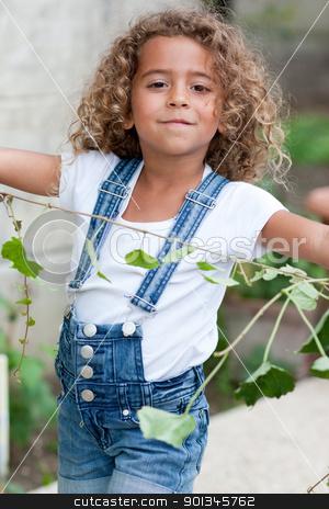 Cute little girl gardening stock photo, Cute little girl weeding the garden by tristanbm