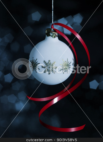 Christmas bauble with red bow stock photo, Christmas bauble in blurry back by prill