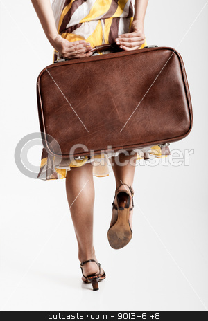 Fashion Woman stock photo, Beautiful fashion woman posing with a vintage suitcase by ikostudio