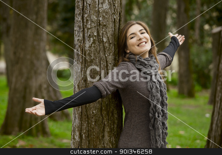 Enjoy the nature stock photo, Portrait of a beautiful young woman relaxing with arms open and enjoying the nature by ikostudio
