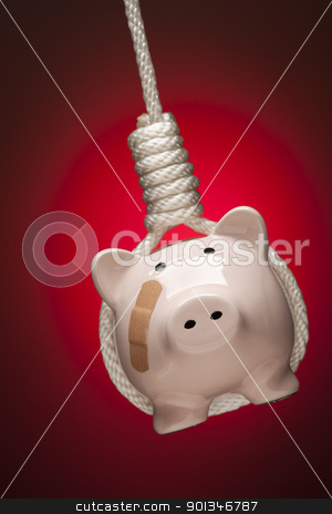 Piggy Bank with Bandage Hanging in Hangman's Noose on Red stock photo, Piggy Bank with Bandage Hanging in Hangman's Noose on Red Spot Lit Background. by Andy Dean