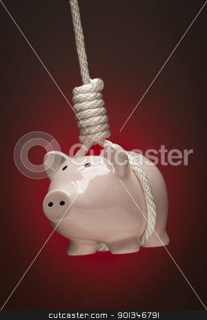 Piggy Bank Hanging in Hangman's Noose on stock photo, Piggy Bank Hanging in Hangman's Noose on Red Spot Lit Background. by Andy Dean