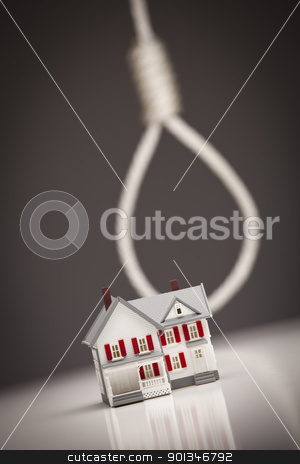 House with Hangman's Noose in Background stock photo, Small House with Hangman's Noose Behind on Grey Background. by Andy Dean