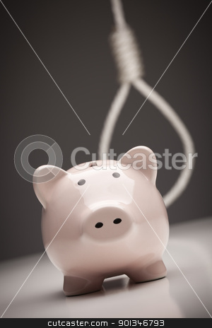 Piggy Bank with Hangman's Noose in Background stock photo, Piggy Bank with Hangman's Noose Behind on Grey Background. by Andy Dean