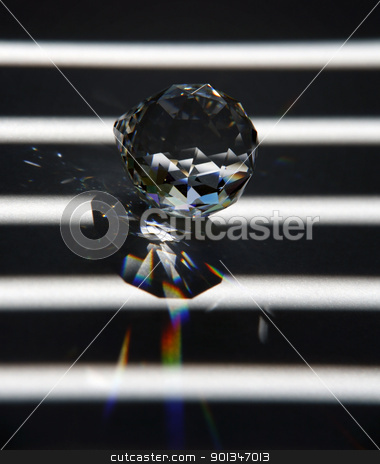 glass object and refraction stock photo, abstract studio photography of a glass diamond and broken light in striped back by prill
