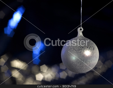 translucent Christmas bauble in dark back stock photo, Christmas bauble in dark blurry back with copyspace by prill