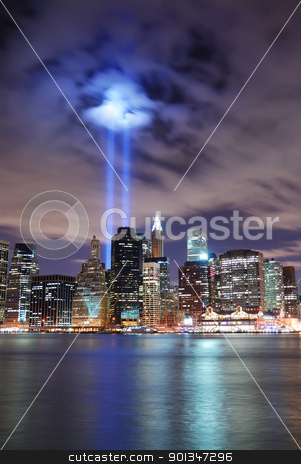 New York City stock photo, Remember September 11. New York City Manhattan panorama view at night with office building skyscrapers skyline illuminated over Hudson River and two light beam in memory of September 11. by rabbit75_cut