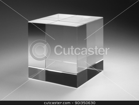 solid glass cube stock photo, studio photography of a solid glass cube in gradient back by prill