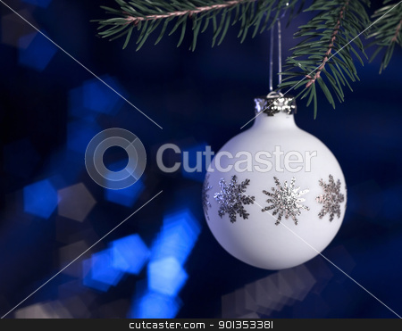 white Christmas bauble in dark blue back stock photo, Christmas bauble hanging on fir branch in dark blurry back by prill