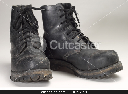 combat boots stock photo, a pair of used black combat boots by prill