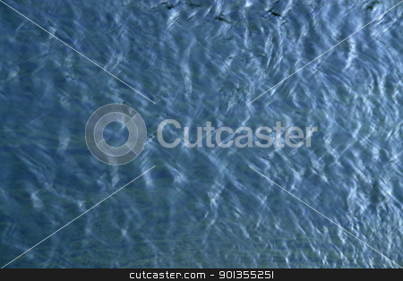 blue water surface stock photo, abstract background of a water surface with small waves by prill