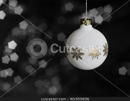 white Christmas bauble stock photo, Christmas bauble with metallic ornaments in blurry back by prill