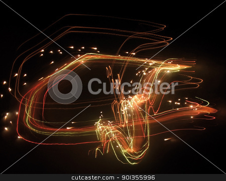 fireworks stock photo, a swinging colorful pyrotechnic effect in dark back by prill