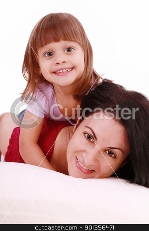 A portrait of a mother and her baby girl lying on the bed and sm stock photo, A portrait of a mother and her baby girl lying on the bed and smiling over white background   by dacasdo